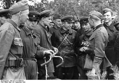Allied Soviet and Nazi soldiers meet after invasion of Poland.