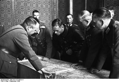 Nazi and Soviet Officers coordinate joint activities against Poland.